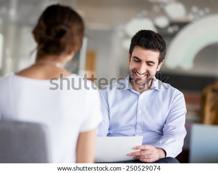 Interview of two business professionals - stock photo