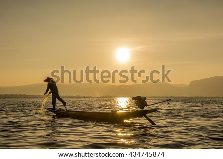 Intha fisherman of Inle Lake, also knows as the leg-rowing fisherman.