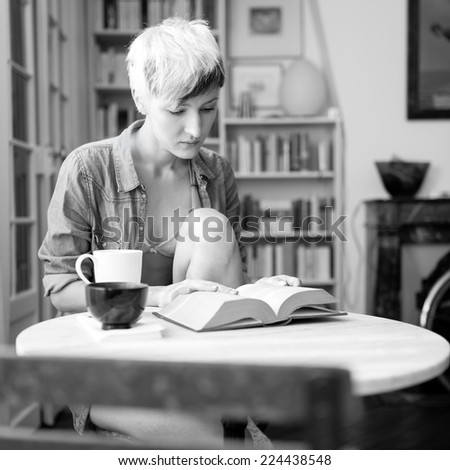 Intimate portrait of beautiful woman relaxing at home. Black and white image.  - stock photo