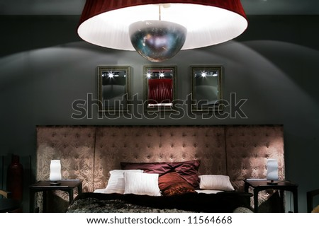 intimate semidarkness under luxurious bed with pillow - stock photo