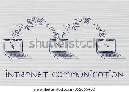 intranet communication: laptops with documents flying from one screen to the other - stock photo