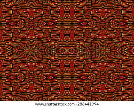 Intricate geometric tribal style abstract seamless pattern in vivid and saturated red and orange colors. - stock photo