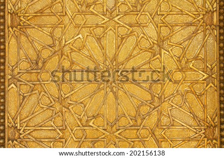 Intricate metal filigree on a gate to the palace of the king of Morocco - stock photo