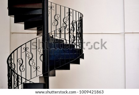 Intricate Wrought Iron Exterior Spiral Staircase On The Side Of A Shop  House In Singapore With