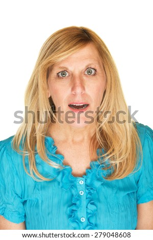 Intrigued middle aged Caucasian female in blue - stock photo