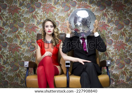 introducing mr and mrs discoball. two cool club characters dance and pose in a nightclub setting  - stock photo