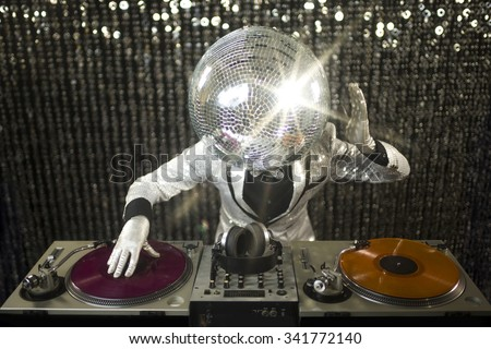 introducing mr discoball. a cool club character DJing in a club - stock photo