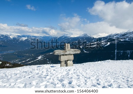 Inukshuk in the snow at Whistler - stock photo