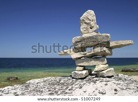 Inukshuk on Georgian Bay Shore - stock photo