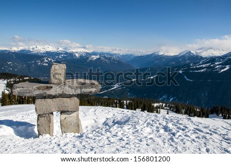 Inukshuk on top of a sunny Whistler Mountain - stock photo