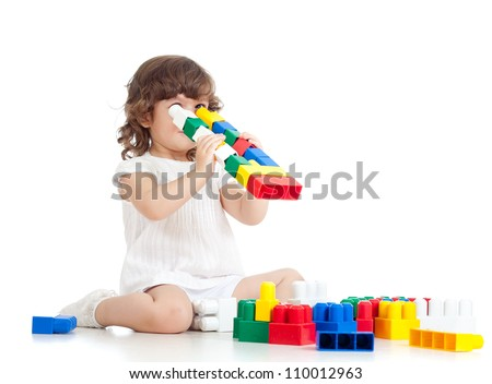inventive kid with construction set toy over white background
