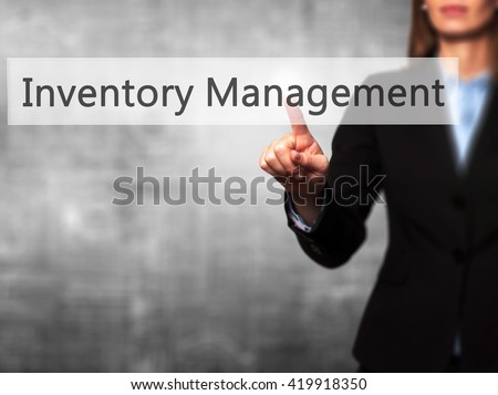 Inventory Management - Businesswoman hand pressing button on touch screen interface. Business, technology, internet concept. Stock Photo - stock photo