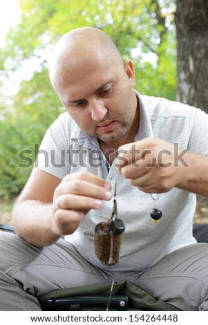 invents anglers bait for catching big fish - stock photo