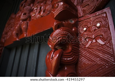INVERCARGILL - DECEMBER 24: Exterior view of colourful carvings on a Maori meeting house (Marae) on December 24 2008 in Invercargill, New Zealand.