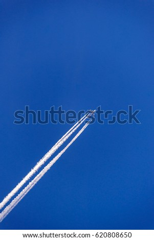 Inversion trail of airplane in the sky, Vertical frame