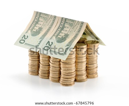 Invest in real estate concept. Twenty US dollar bill roof on coins isolated on white background. - stock photo