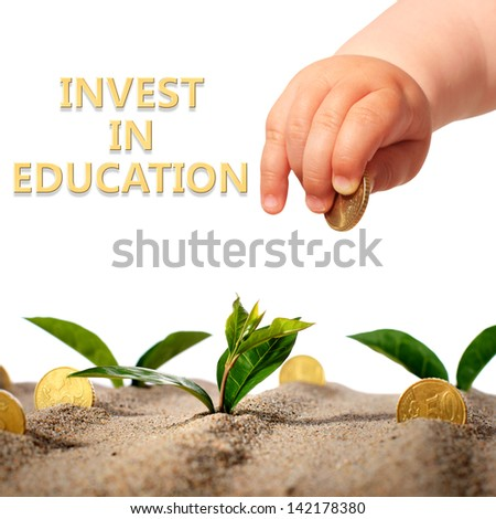 Invest in yourself. Hand with coin and plants. - stock photo