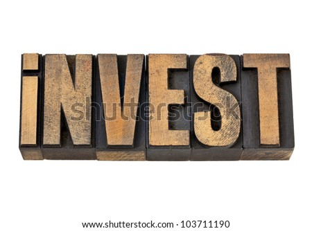 invest  - isolated word in vintage letterpress wood type - stock photo