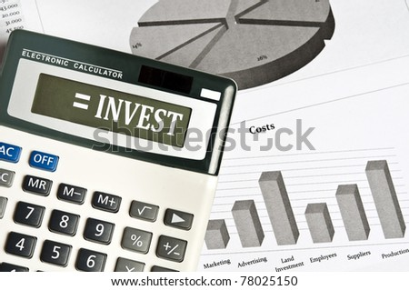Invest word on electronic calculator - stock photo