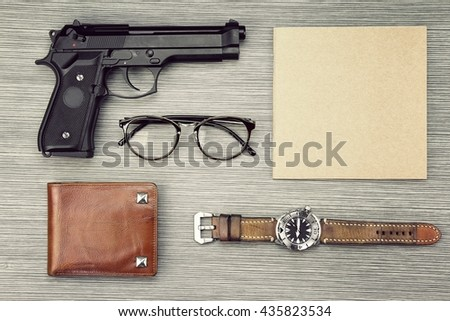Investigation Concept. Private Detective Tools On The Woodden Background, Guns, Watch, Notebook, Wallet, Glasses. (Color Process) - stock photo