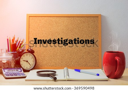 "Investigations Concept,Wood boards with text inside ""Investigations"" on table with coffee. office equipment - stock photo"