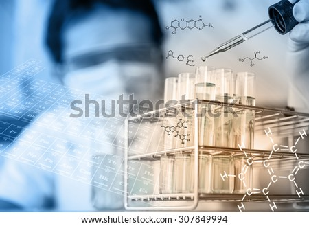 Investigator checking test tubes. Man wears protective gogglesมresearcher is testing, dropping reagent to test tube at laboratory with chemical equations and periodic table background. - stock photo