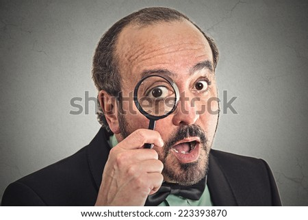 investigator man looking with magnifying glass - stock photo