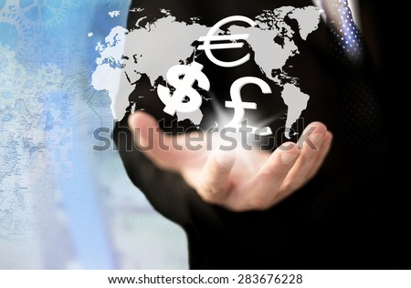 Investment concept. Businessman  holding currency symbols.         - stock photo