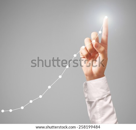 Investment concept,businessman with financial symbols coming from hand  - stock photo