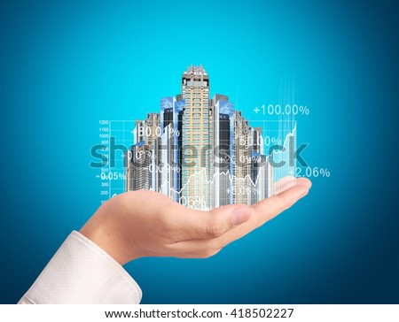 Investment concept, businessman with financial symbols coming from hand
