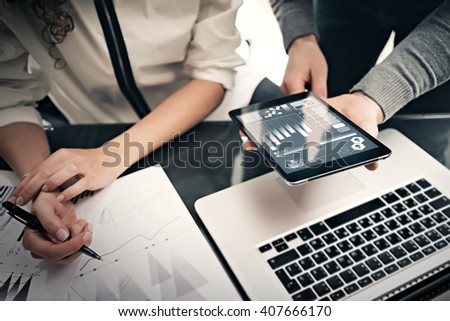 Investment department working process.Photo finance manager showing reports modern tablet screen.Statistics graphics screen.Private banker holding pen for signs documents, business project.Horizontal - stock photo