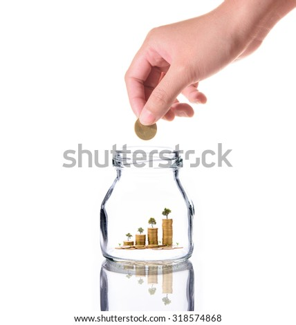 Investment growth concept,Golden coins and tree in clear jar over white background,saving money with woman hand - stock photo