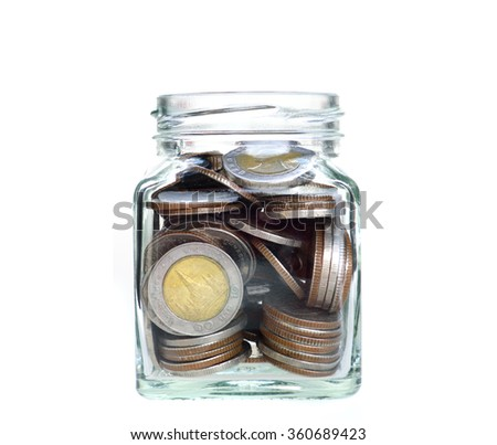 Investment growth concept,mixs coins in clear jar over white background,saving money