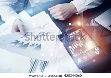 Investment manager working process.Concept photo trader work market report modern tablet.Using electronic device.Graphic icons,stock exchange reports screen interfaces.Business startup.Flares effect. - stock photo