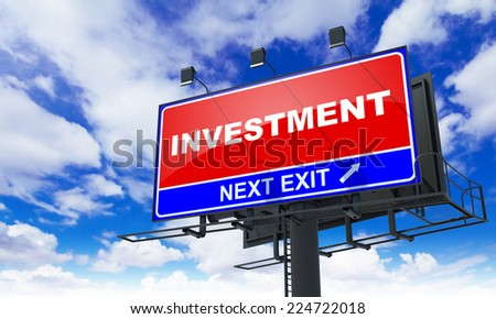 Investment - Red Billboard on Sky Background. Business Concept. - stock photo