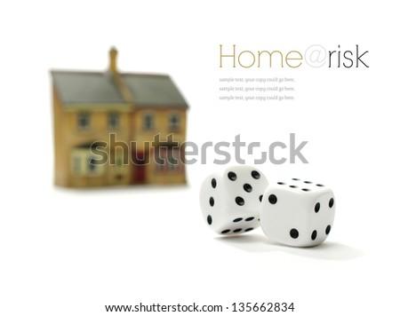 Investment risk concept stock photograph. Rolling dice and property against a white background. Copy space. - stock photo