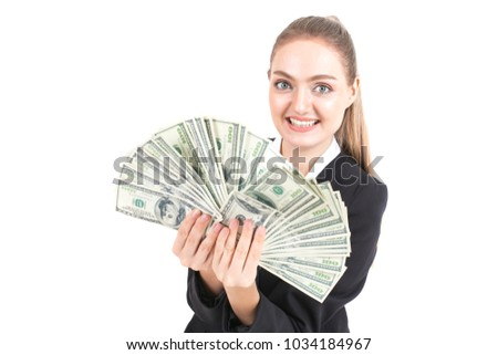 Investor female holding money with smile isolated on white background.