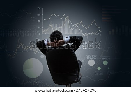 Investor with growth chart of profits. - stock photo