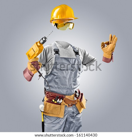 invisible worker in helmet with drill - stock photo