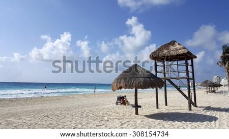 Inviting always warm Cancun white sand beach, La Isla Dorado, Mexico - stock photo