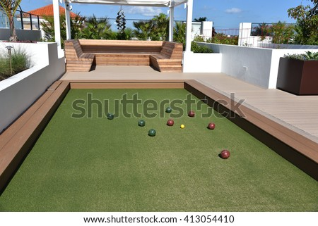 Inviting bocce ball court on artificial turf - stock photo