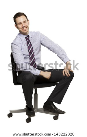Inviting business man sitting on chair with relaxed attitude - stock photo