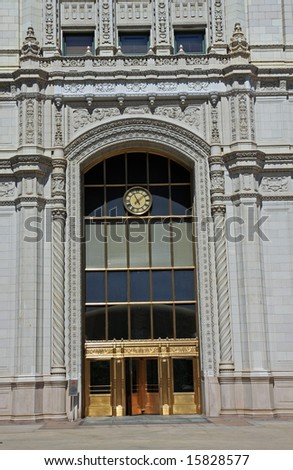 Inviting entry architecture on the Wrigley Building, a vintage structure in downtown Chicago - stock photo