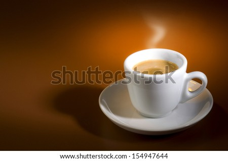 inviting hot cup of coffee with vapor steam coming from,  on a small white plate - stock photo