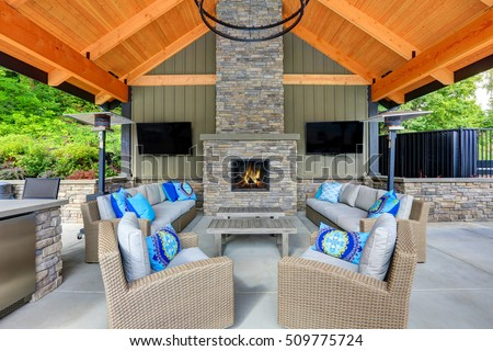 Inviting Interior Of Covered Patio Area In Tacoma Lawn Tennis Club. Stone  Fireplace, Wicker