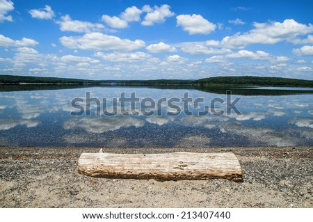 Inviting log at waters edge - stock photo
