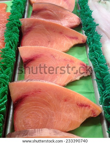 Inviting Swordfish fillets in a display case - stock photo