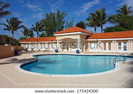 Inviting upscale pool and cabana in South Florida - stock photo