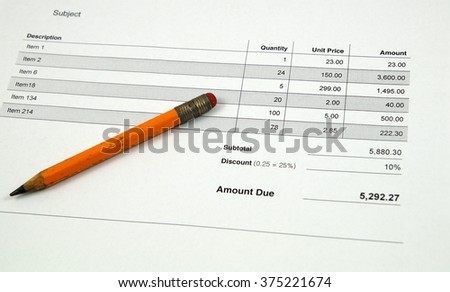 Invoice and pencil