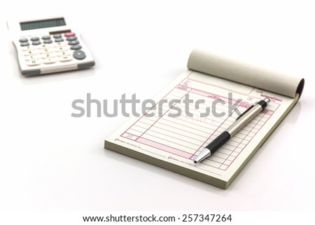 Invoice book which open blank page with pen and calculator on white background. - stock photo